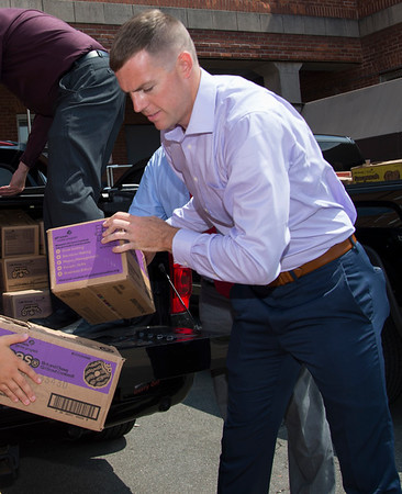 08/14/19 Wesley Bunnell | Staff Congressional candidate John Cain helps unload Girl Scout cookies from a truck at the Newington VA on Wednesday August 14, 2019. The candidate, through donations from the Girl Scouts, delivered over three thousand boxes of cookies to his fellow veteran along with the help of congressional candidate Justin Anderson and candidate for senate Robert F Hyde.