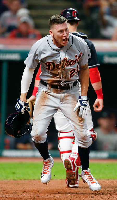 . Detroit Tigers\' JaCoby Jones reacts after scoring on a wild pitch by Cleveland Indians\' Neil Ramirez during the eighth inning of a baseball game, Friday, Sept. 14, 2018, in Cleveland. (AP Photo/Ron Schwane)