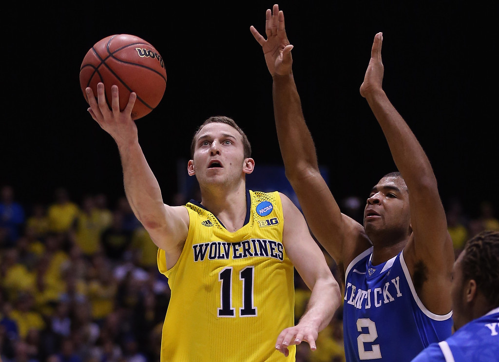 . Nik Stauskas #11 of the Michigan Wolverines shoots the ball against Aaron Harrison #2 of the Kentucky Wildcats during the midwest regional final of the 2014 NCAA Men\'s Basketball Tournament at Lucas Oil Stadium on March 30, 2014 in Indianapolis, Indiana.  (Photo by Jonathan Daniel/Getty Images)
