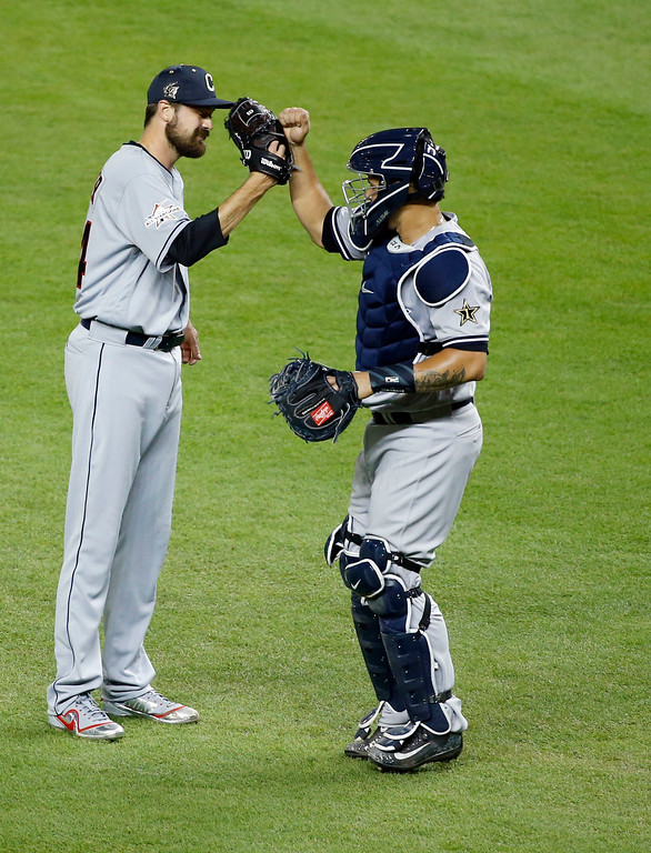 . American League\'s Cleveland Indians pitcher Andrew Miller, congratulates New York Yankees catcher Gary Sánchez, after winning the MLB baseball All-Star Game, Tuesday, July 11, 2017, in Miami. The American League defeated the National League 2-1. (AP Photo/Wilfredo Lee)