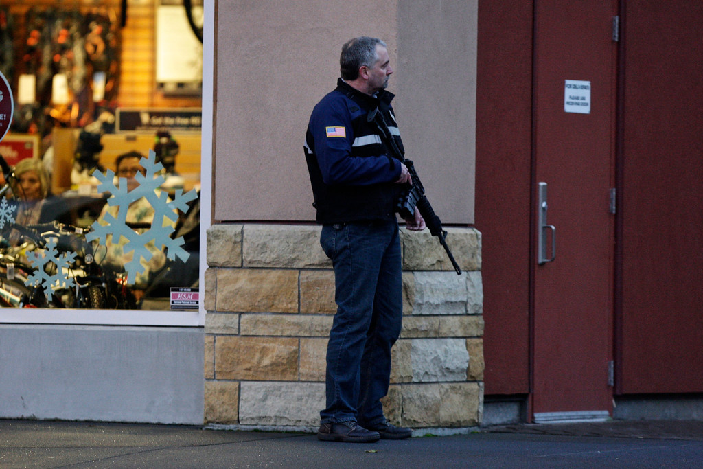 . A law enforcement official secures the scene after a shooting at Clackamas Town Center in Portland, Ore., Tuesday, Dec. 11, 2012. A gunman is dead after opening fire at the shopping mall Tuesday, killing two people and wounding another, sheriff\'s deputies said. (AP Photo/The Oregonian, Thomas Boyd)