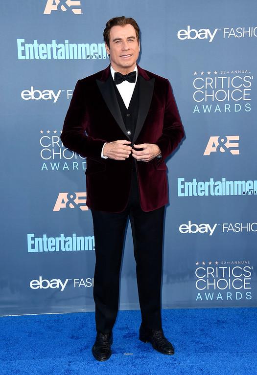 . John Travolta arrives at the 22nd annual Critics\' Choice Awards at the Barker Hangar on Sunday, Dec. 11, 2016, in Santa Monica, Calif. (Photo by Jordan Strauss/Invision/AP)