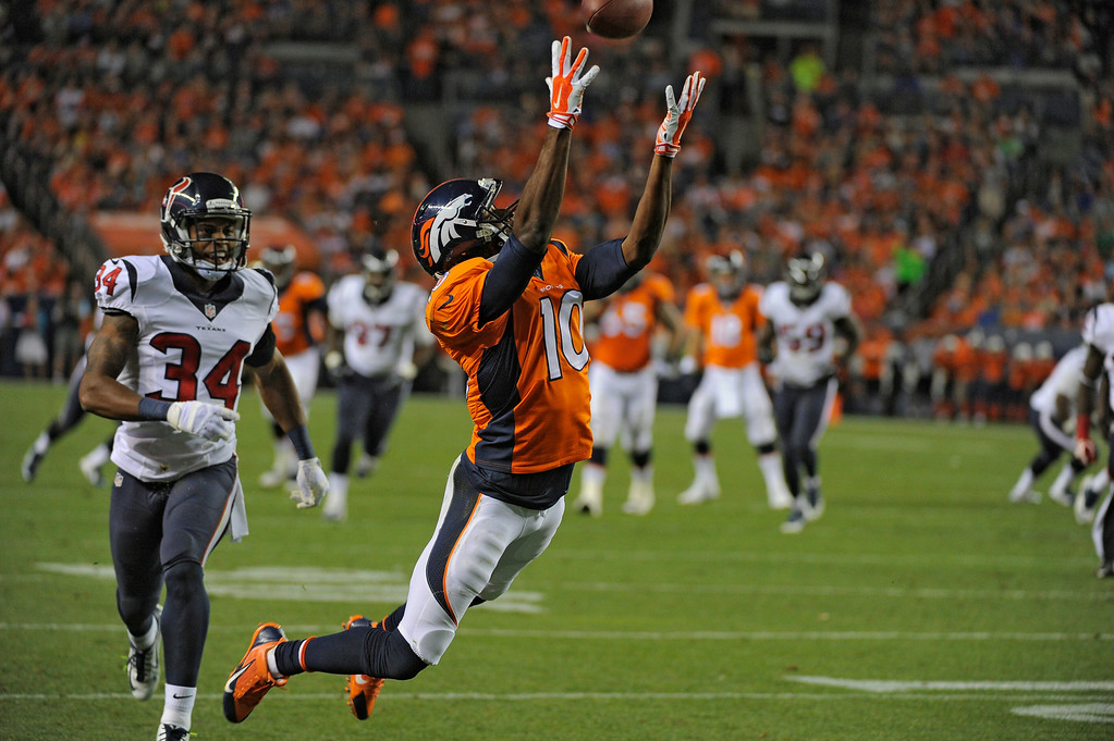 . DENVER, CO - AUGUST 23: Denver Broncos wide receiver Emmanuel Sanders (10) goes up for a pass for a touchdown as Houston Texans cornerback A.J. Bouye (34) watches the play during the second quarter August 23, 2014 at Sports Authority Field at Mile High Stadium. (Photo by John Leyba/The Denver Post)
