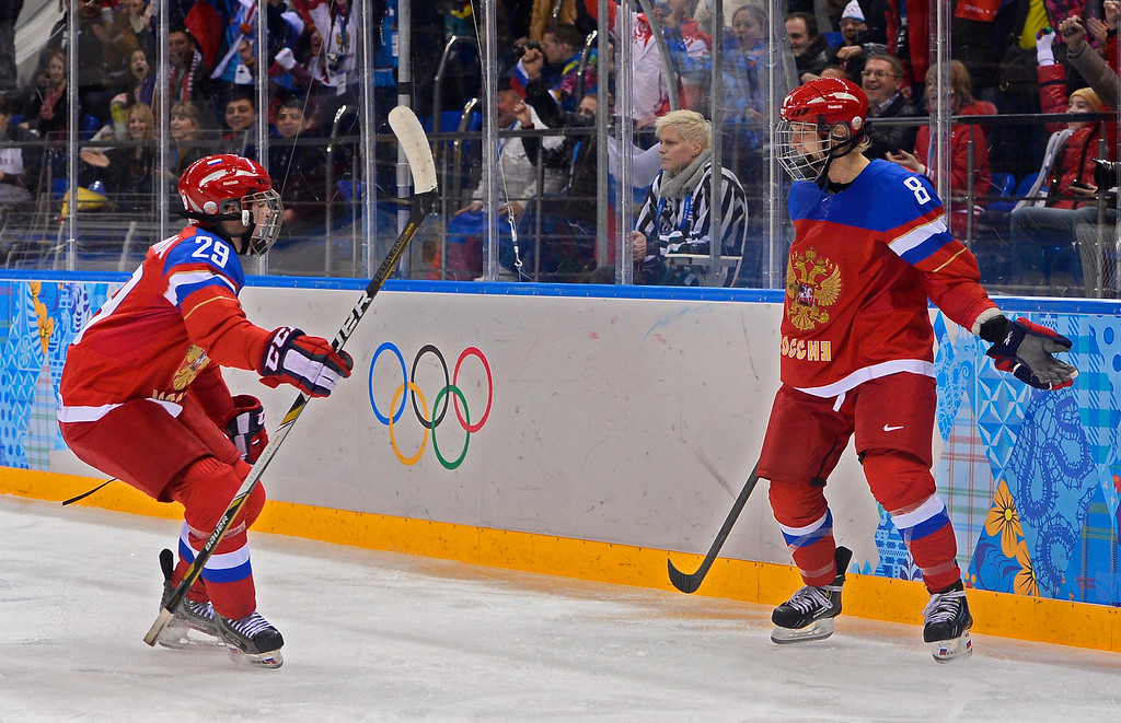 . Iya Gavrilova (R) celebrates with teammate Anna Shokhina (L) of Russia after scoring a goal against Germany in the third period during their match in the Ice Hockey tournament at the Sochi 2014 Olympic Games in Sochi, Russia, 09 February 2014.  EPA/LARRY W. SMITH