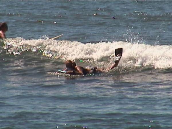 Sheryl catching wave.jpg