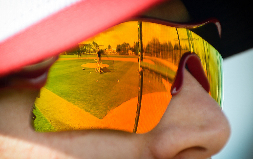 . The field is reflected in outfielder Chris Parmelee\'s sunglasses. (Pioneer Press: Ben Garvin)