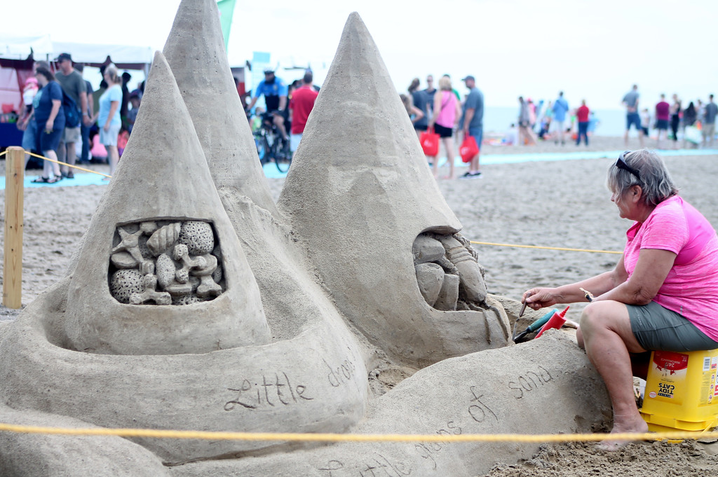 . Suzanne Altamare of Daytona, Florida, was one of three master sand sculptors participating in the 2017 Mentor Beachfest Headlands Beach State Park. The 2018 event is 11 a.m. to 7 p.m. July 21. For more information, visit cityofmentor.com/departments/parks-recreation/events/headlands-beachfest. (Kristi Garabrandt/The News-Herald)