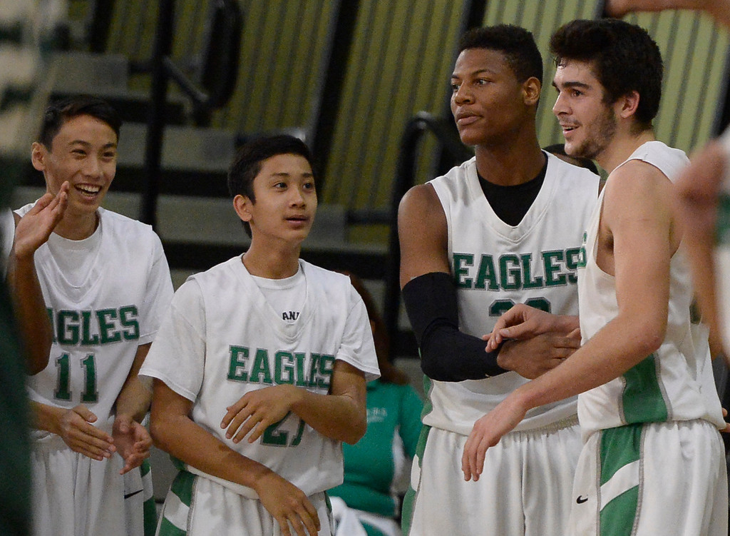 . Eagle Rock#32 Stewart Ramirez, right, is congratulated by his team mates in the final seconds of the game. The boys from Eagle Rock defeated Hamilton 68-56 in the City Section Division III Boys basketball final. Los Angeles, CA. March 8, 2014 (Photo by John McCoy / Los Angeles Daily News)