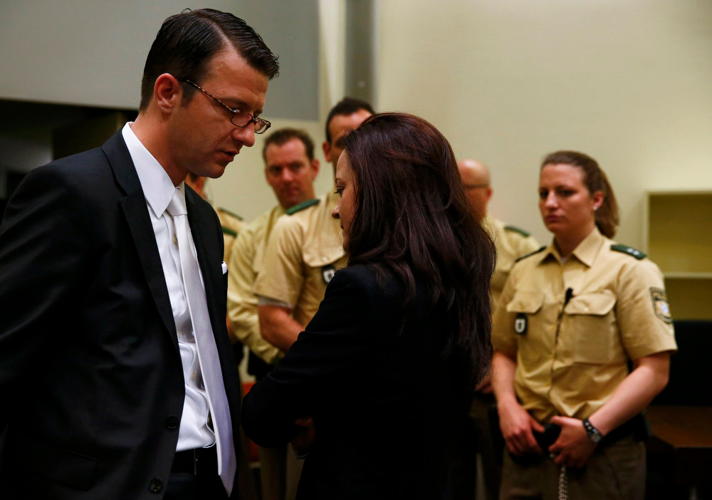 . Beate Zschaepe, a member of the neo-Nazi group National Socialist Underground (NSU), speaks to her lawyer Wolfgang Stahl in the court before the start of the trial in Munich on May 6, 2013. The surviving member of NSU blamed for a series of racist murders that scandalized Germany and shamed its authorities goes on trial on Monday in one of the most anticipated court cases in recent German history. The trial in Munich will focus on 38-year-old Zschaepe, who is charged with complicity in the murder of eight Turks, a Greek and a policewoman between 2000-2007, as well as two bombings in immigrant areas of Cologne, and 15 bank robberies.  REUTERS/Michael Dalder