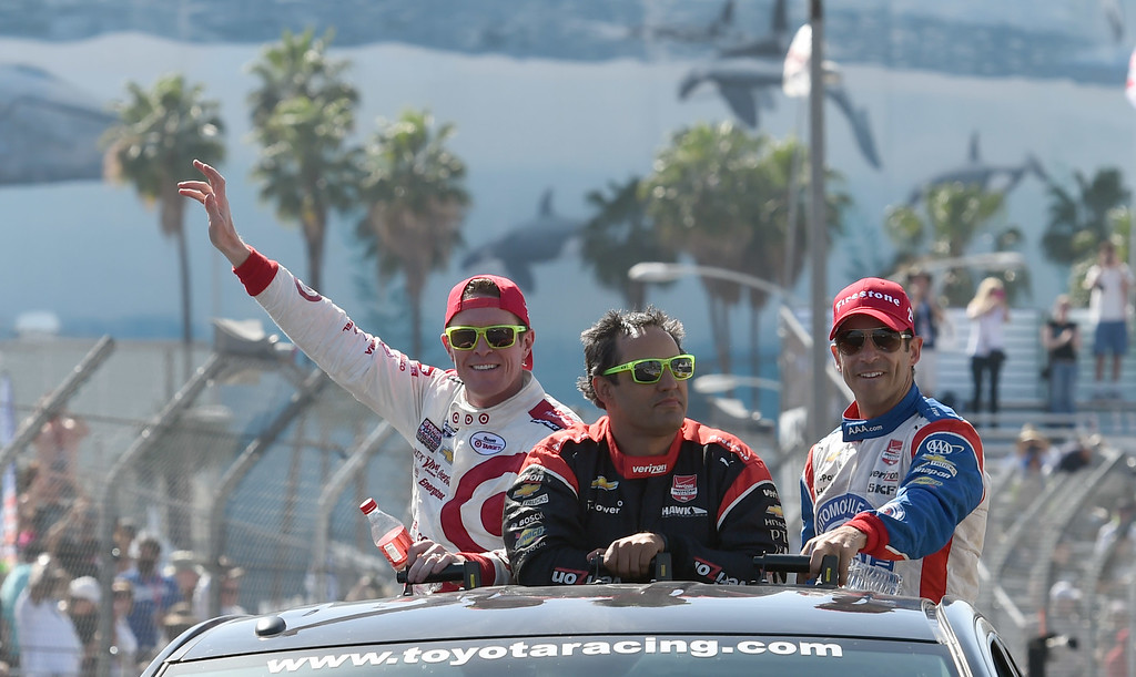 . Toyota Grand Prix of Long Beach winner Scott Dixon, left, 3rd place finisher Juan Pablo Montoya, center, and  2nd place finisher Helio Castroneves, take a victory lap in the winners truck Sunday afternoon.   Long Beach  Calif., Sunday,  April,19, 2015.     (Photo by Stephen Carr / Daily Breeze)