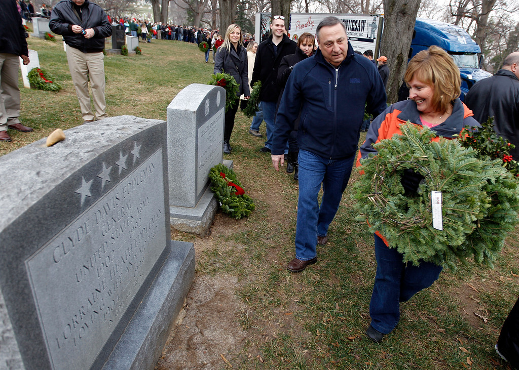 . Gov. Paul LePage of Maine and his wife Ann lay holiday wreaths at the graves of fallen soldiers at Arlington National Cemetery in Arlington, Va., Saturday, Dec. 15, 2012, during Wreaths Across America Day. Wreaths Across America was started in 1992 at Arlington National Cemetery by Maine businessman Morrill Worcester and has expanded to hundreds of veterans\' cemeteries and other locations in all 50 states and beyond. (AP Photo/Jose Luis Magana)