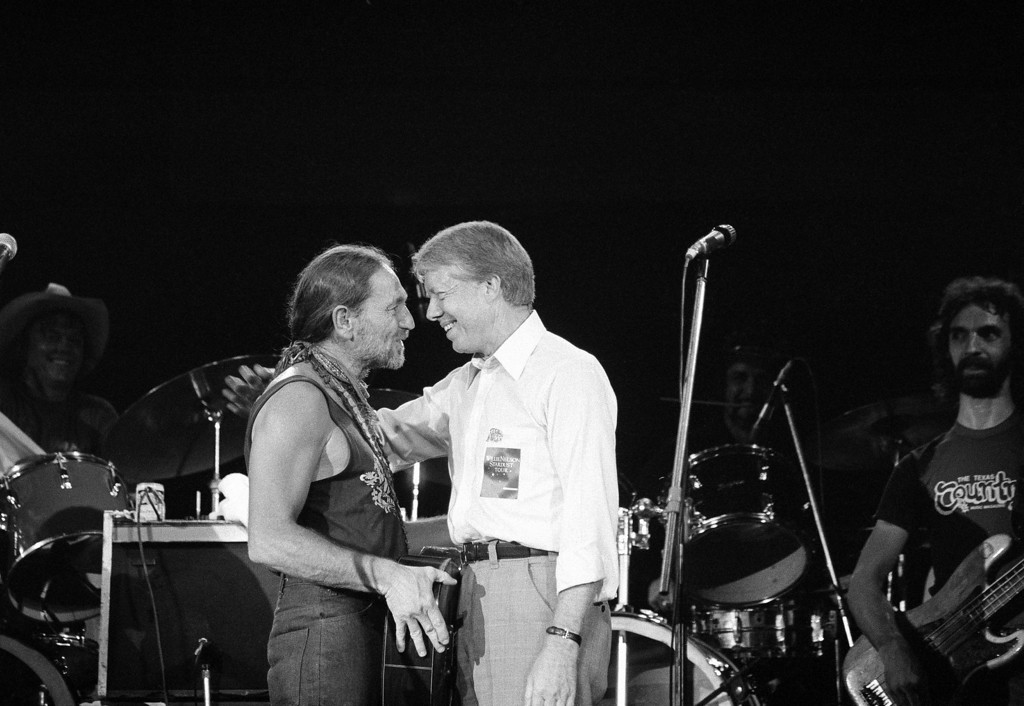 . President Jimmy Carter greets Willie Nelson, left, after watching the star country and western music singer perform in a concert at the Merriweather Post Pavillion at Columbia, Md., on July 21, 1978. Nelson performed along with country western singer Many Lou Morris for the President Jimmy Carter and Mrs. Rosalynn Carter who joined thousands of young people for the show. (AP Photo/Charles Tasnadi)
