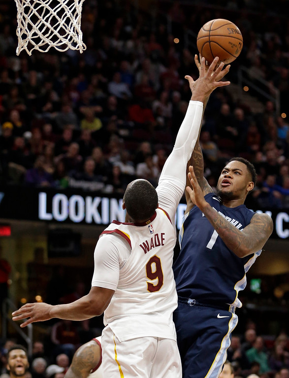 . Memphis Grizzlies\' Jarell Martin (1) shoots over Cleveland Cavaliers\' Dwyane Wade (9) in the second half of an NBA basketball game, Saturday, Dec. 2, 2017, in Cleveland. (AP Photo/Tony Dejak)