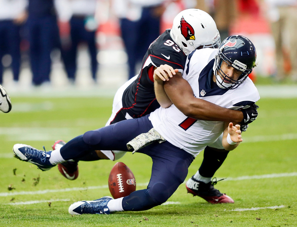 . Arizona Cardinals defensive end Calais Campbell, left, sacks Houston Texans quarterback Case Keenum during the first half of an NFL football game Sunday, Nov. 10, 2013, in Glendale, Ariz. (AP Photo/Matt York)