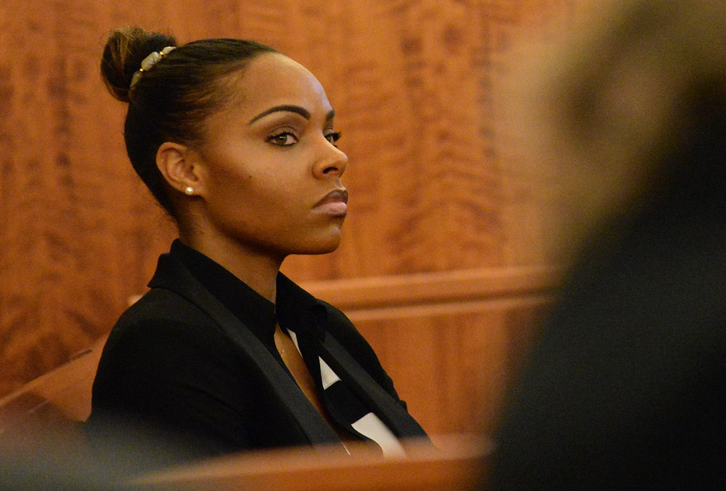. Shayanna Jenkins, the fiancee of former New England Patriots football player Aaron Hernandez, listens during his murder trial at Bristol County Superior Court, Thursday, Feb. 5, 2015, in Fall River, Mass. Hernandez is accused of the June 2013 killing of Odin Lloyd.   (AP Photo/Faith Ninivaggi, Pool)