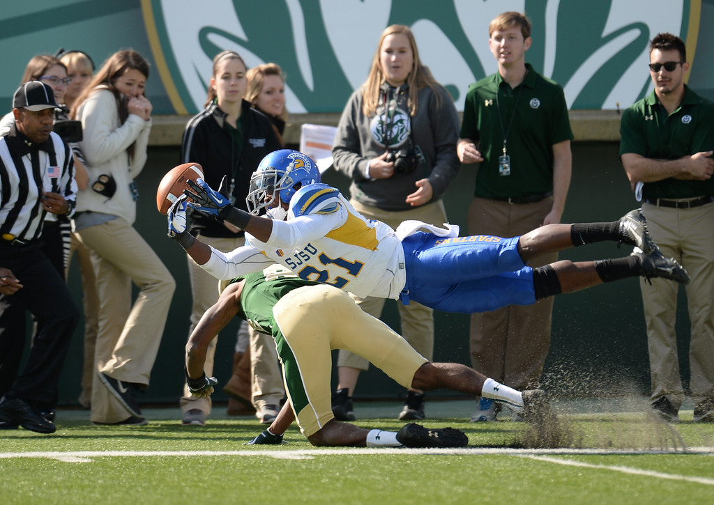 . FORT COLLINS, CO - OCTOBER 12 : Bene Benwikere of San Jose State (21), top, breaks the catch of Rashard Higgins of Colorado State (82) in the 2nd quarter of the game at Hughes Stadium. Fort Collins. Colorado. October 12, 2013. San Jose won 34-27. (Photo by Hyoung Chang/The Denver Post)