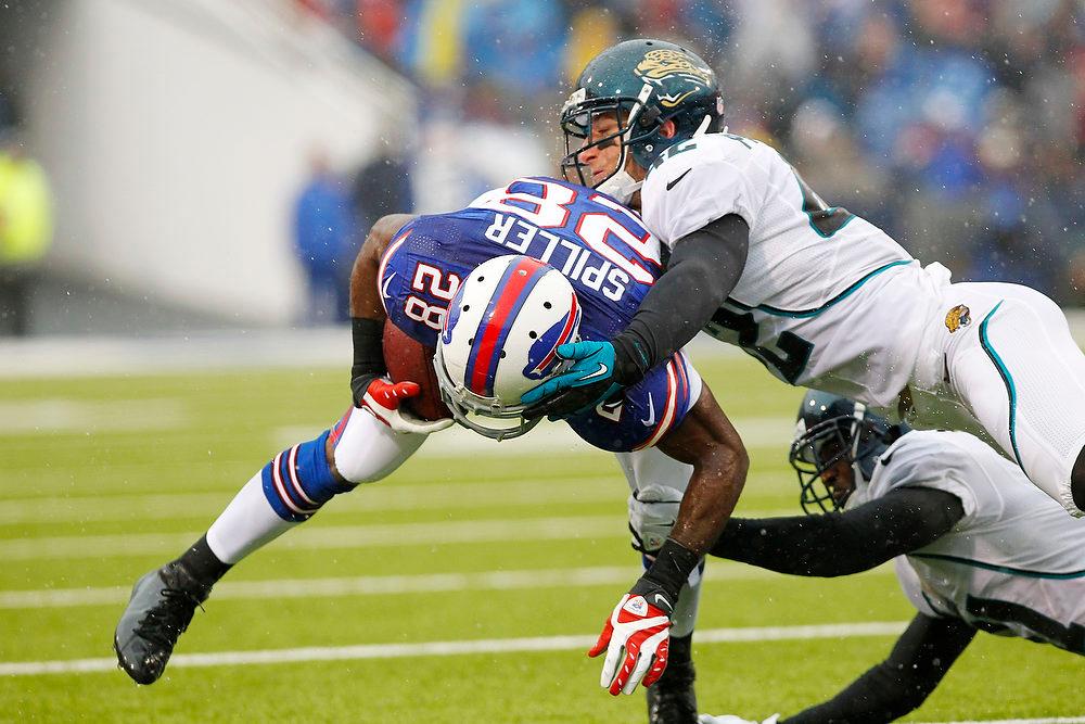 . Jacksonville Jaguars\' Chris Prosinski (42) tackles Buffalo Bills\' C.J. Spiller (28) during the first half of an NFL football game, Sunday, Dec. 2, 2012, in Orchard Park, N.Y. (AP Photo/Bill Wippert)