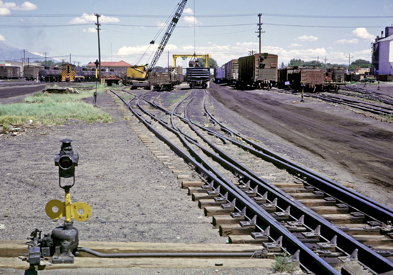 July 1963.  Alamosa yard.  This is where standard gauge cars and narrow gauge cars transloaded freight. Most of the yard was three rail to accommodate both guages.