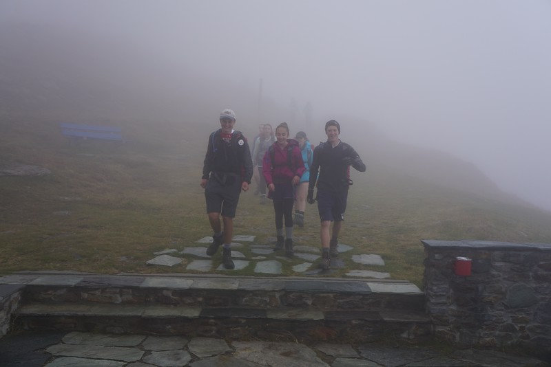 Arriving in the fog is Matthew, Phaedra, and John with Claire, Jane, and Cara in the background