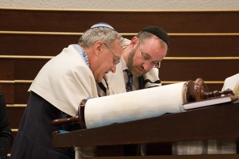 Larry Sidman assists Sofer Rabbi Menachem Youlus completing the last letter of the new Torah -- Siyum HaTorah -- Beth El's Project 613: Writing a Torah