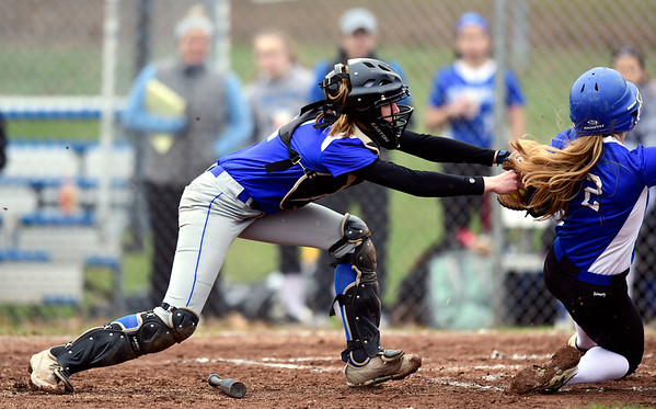 4/9/2019 Mike Orazzi | Staff Bristol Eastern's Paige McLaughlin (2) tags out Southington's Chrissy Marotto (2) during Tuesday's softball game in Bristol.