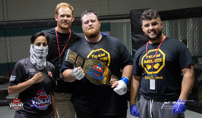 Charles Miles  (W) and Team with Cindy Rodriguez    $ecure Tha Bag at Largo's Minnreg Hall on July 11, 2020.  Combat Quest 8 featured 17  bouts consisting of boxing, San Shou Kickboxing, BJJ, CJJ & MMA. To include Title fights and defenses.  Brandon Lee of Vigilant MMA put on an excellent card. Seating was set appropriately for Social Distancing and everyone was required to wear masks.  Photos by: Joe Mestas www.joemestas.com Available for Promo, events, sports, and photo shoots