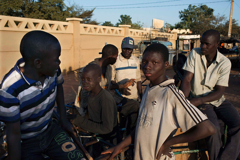 . Boys chat in front of the grand mosque in Segou January 17, 2013. REUTERS/Joe Penney