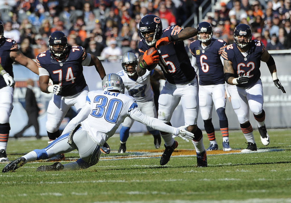 . Brandon Marshall #15 of the Chicago Bears catches a pass in front of Darius Slay #30 of the Detroit Lions during the first quarter on November 10, 2013 at Soldier Field in Chicago, Illinois. (Photo by David Banks/Getty Images)