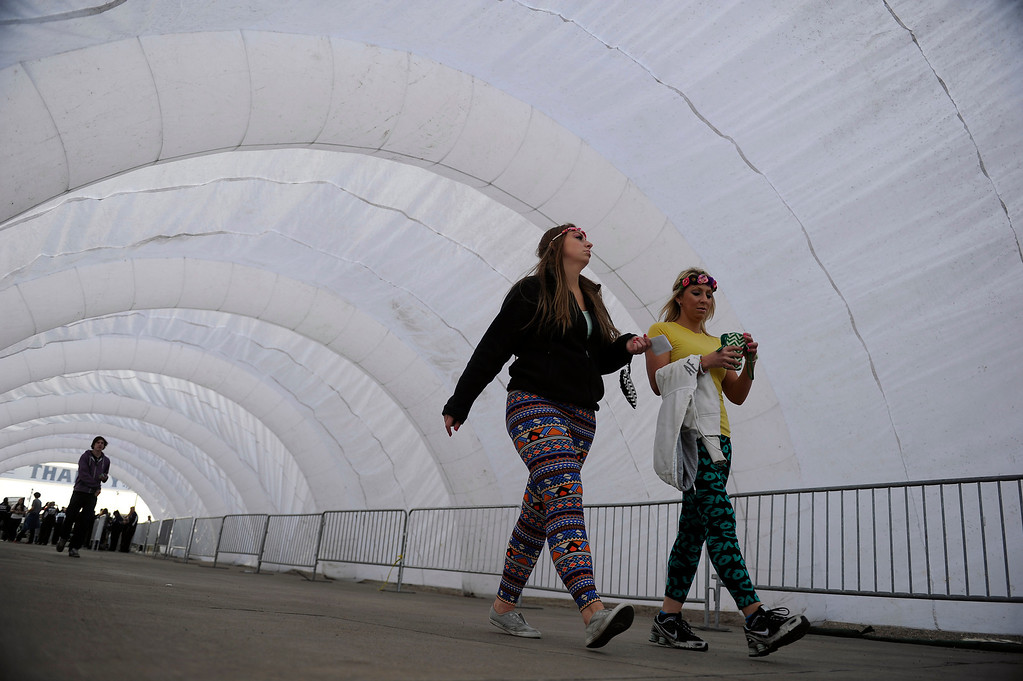 . DENVER, CO - APRIL 4: Attendees enter through a long tunnel during the Snowball Music Festival at Sports Authority Field at Mile High Stadium on April 4, 2014 in Denver, Colorado. The Snowball Music Festival is celebrating its first year in Denver after spending the previous three years as a mountain based festival. (Photo by Seth McConnell/The Denver Post)