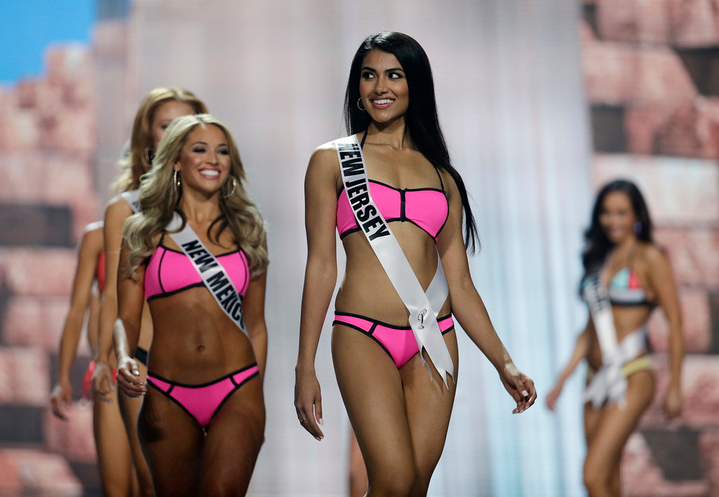 . In this May 11, 2017, photo, Miss New Jersey USA Chhavi Verg competes during a preliminary competition for Miss USA in Las Vegas. Very emigrated from India with her parents. Five of the contestants vying for the Miss USA title this year were born in other countries and now U.S. citizens. (AP Photo/John Locher)