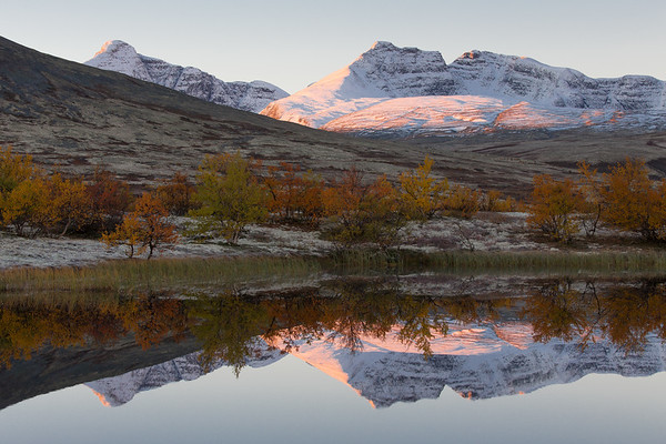 Dørålen valley at sunrise. The mountains in the distance are from left Høgeronden and Midtronden. Rondane, Norway.
