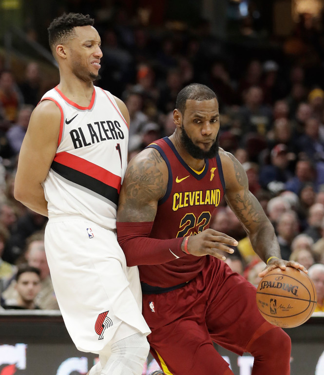 . Cleveland Cavaliers\' LeBron James (23), drives past Portland Trail Blazers\' Evan Turner (1) in the second half of an NBA basketball game, Tuesday, Jan. 2, 2018, in Cleveland. The Cavaliers won 127-110. (AP Photo/Tony Dejak)