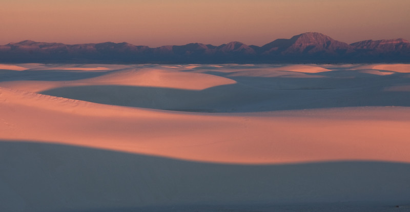 Soft dunes at sunrise with the San Andres mountains in the background