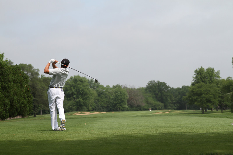 Luis Gagne, of Orlando, Florida, tees off during the third round of the 2014 Western Junior Championship. This shot was the start of Gagne's record-breaking round.