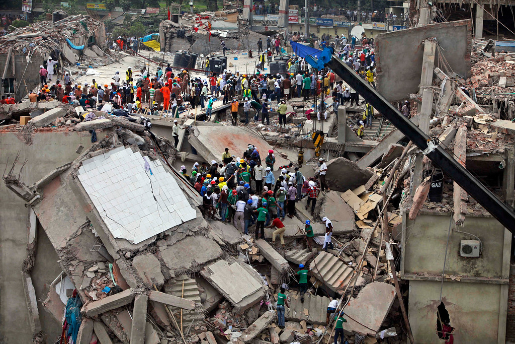 . Bangladeshi rescuers work at the site of a building that collapsed Wednesday in Savar, near Dhaka, Bangladesh, Thursday, April 25, 2013. AP Photo/A.M. Ahad)