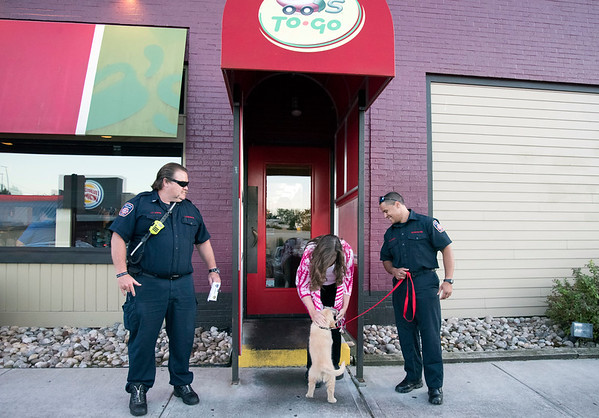 09/25/19 Wesley Bunnell | StaffrrTip a Firefighter took pace at Chili's in New Britain on Wednesday night. The event raised money for the city 's partnership with the community foundation regarding the new disaster relief program. Lt. Davis, L, looks on as a customer plays with a six month old lab puppy named Ash owned by Firefighter Mason, R.