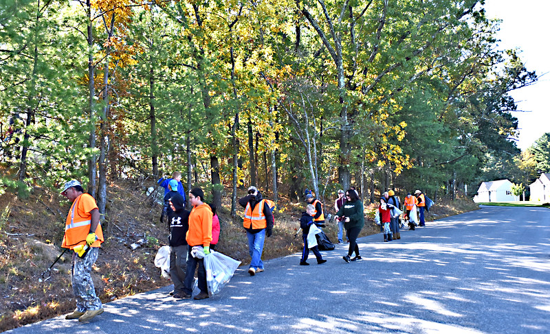 Some of the 65 volunteers for the community clean-up along Coburn Road in Dracut, with members of the Centerville Sportsmen Club, Cub and Boy Scouts from Pack 8 and Troop 80 and members of the Crew 308. SUN/David H.Brow