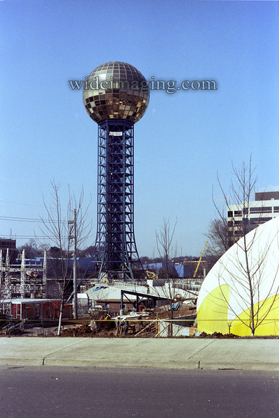 "From early 1982, with the Fair site still under construction. The sign under the Sunsphere reads ""Bohem Architectural Enclosures"""
