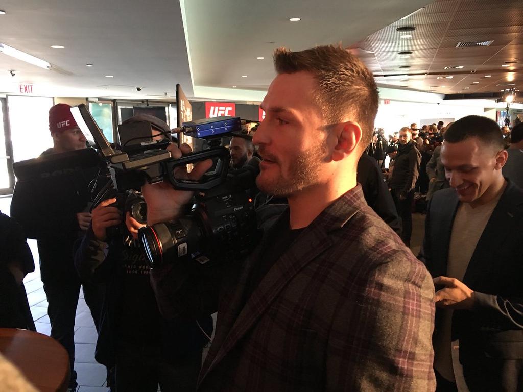 . Stipe Miocic talks to the media at UFC 220 media day (Mark Podolski, The News-Herald)