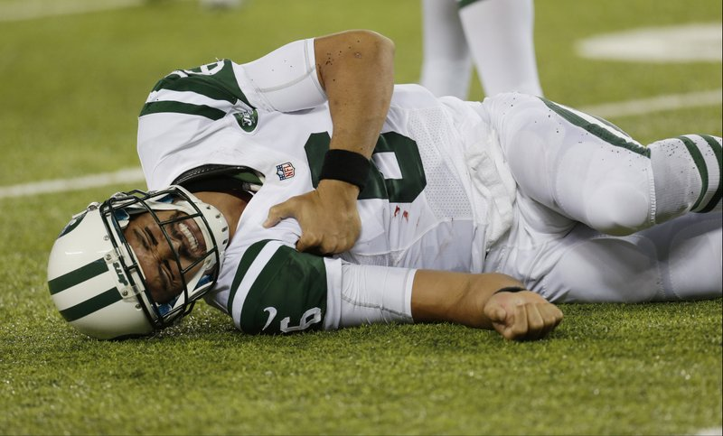 """. <p>5. MARK SANCHEZ <p>Probably finished as a Jet, but at least we had the Buttfumble ... (unranked) <p><b><a href=\'http://www.usatoday.com/story/sports/nfl/jets/2013/09/12/mark-sanchez-shoulder-surgery-possible-torn-labrum-james-andrews/2803067/\' target=\""""_blank\""""> HUH?</a></b> <p>    (AP Photo/Julio Cortez)"""