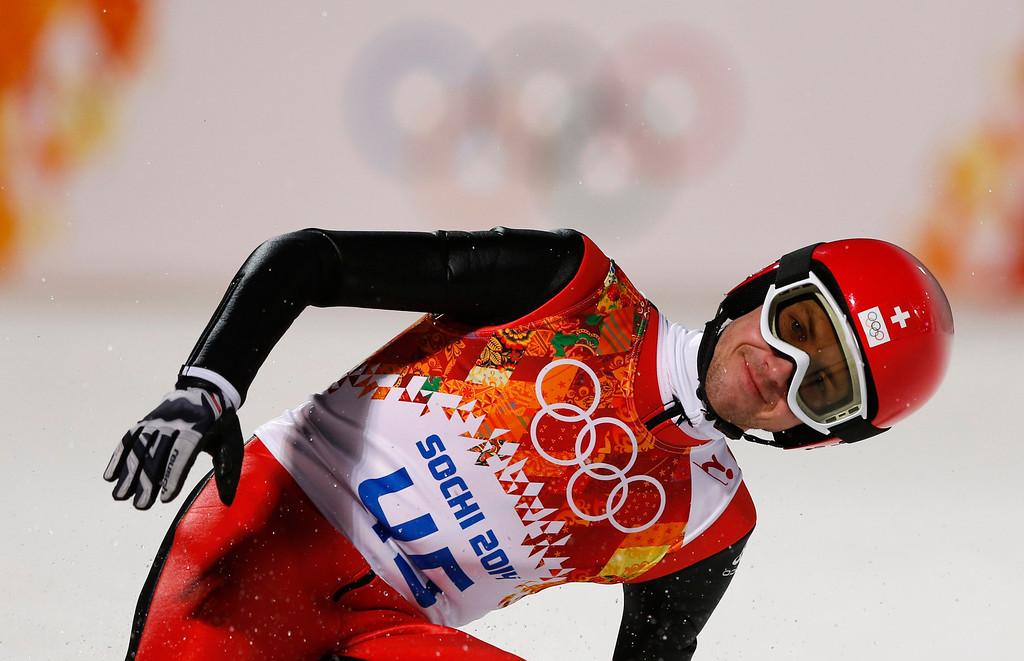 . Switzerland\'s Simon Ammann smiles after his second attempt during the men\'s normal hill ski jumping final at the 2014 Winter Olympics, Sunday, Feb. 9, 2014, in Krasnaya Polyana, Russia. (AP Photo/Matthias Schrader)