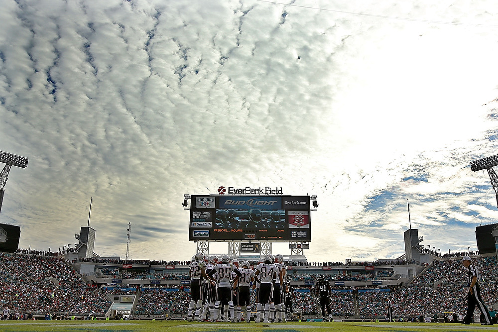. The New England Patriots huddle during a game against the Jacksonville Jaguars at EverBank Field on December 23, 2012 in Jacksonville, Florida.  (Photo by Mike Ehrmann/Getty Images)