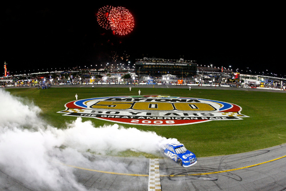 Description of . Ryan Newman does a burnout after winning the NASCAR Sprint Cup Series Daytona 500 auto race at Daytona International Speedway on Sunday, Feb. 17, 2008 in Daytona Beach, Fla.  (AP Photo/Jamie Squire, Pool)