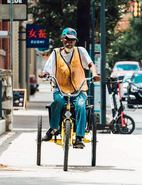 Newsman on a bike 1.jpg