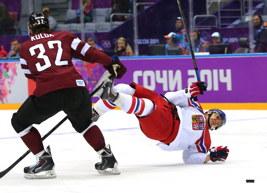 . Martin Erat #91 of Czech Republic falls to the ice against Arturs Kulda #32 of Latvia in the second period during the Men\'s Ice Hockey Preliminary Round Group C game on day seven of the Sochi 2014 Winter Olympics at Bolshoy Ice Dome on February 14, 2014 in Sochi, Russia.  (Photo by Martin Rose/Getty Images)