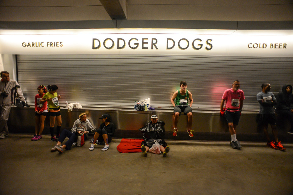 . Runners wait inside Dodger Stadium before the start of the LA Marathon Sunday. Photo by David Crane/Staff Photographer