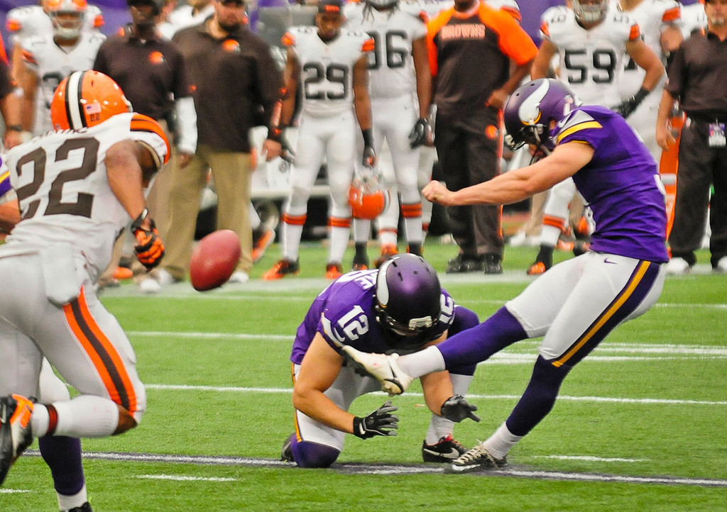 . Vikings kicker Blair Walsh kicks a 30-yard field goal from the hold of Jeff Locke  in the fourth quarter against the Browns.  (Pioneer Press: Ben Garvin)