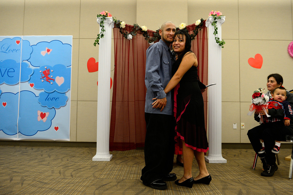 . DENVER, CO - FEBRUARY 14: Victor Manuel Villalobos Ramirez and Antonia Vanessa Carreon pose after saying their vows during a Valentine\'s Day marriage celebration at the Denver Clerk and Recorder\'s office. Couples applying for marriage licenses received gift bags containing gift certificates to local restaurants among other treats to celebrate their union. (Photo By AAron Ontiveroz/The Denver Post)