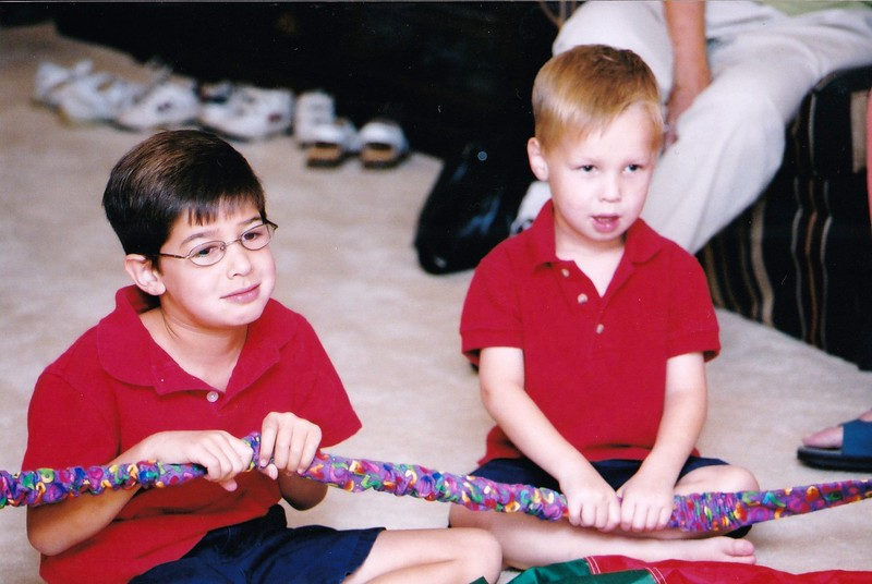 2003-08 Josh & Adam hold rope at Adam's birthday party.jpg