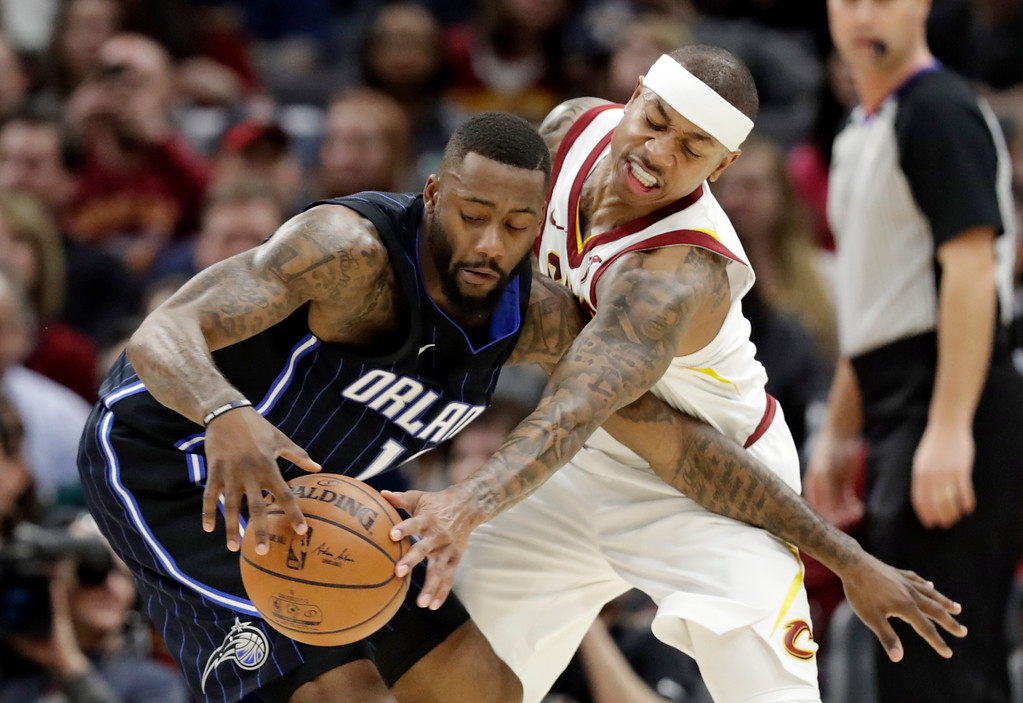 . Cleveland Cavaliers\' Isaiah Thomas, right, defends against Orlando Magic\'s Jonathon Simmons during the first half of an NBA basketball game Thursday, Jan. 18, 2018, in Cleveland. The Cavaliers won 104-103. (AP Photo/Tony Dejak)